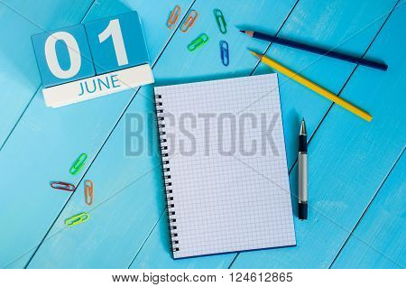 June 1st. Image of june 1 wooden color calendar on blue background.  First summer day. Empty space for text. Happy Childrens Day.