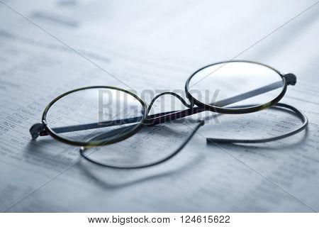 vintage glasses on newspaper