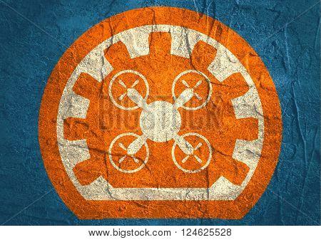 Drone quadrocopter emblem. Concrete textured image. Copter icon