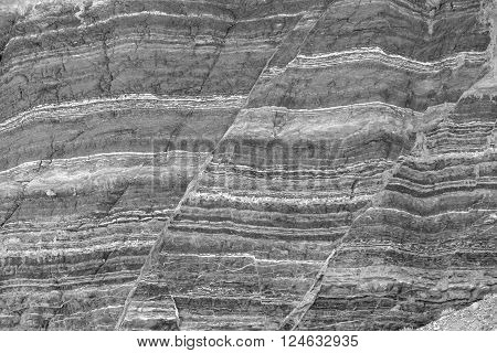 Fault lines and layers in sandstone also useful as a background or texture in black and white.
