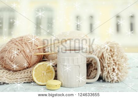 Beautiful winter composition with cup of hot drink on windowsill