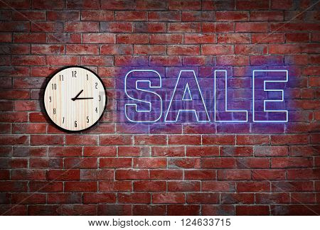 Sale concept. Clock on brick wall background