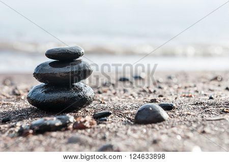 Stones Pyramid On The Beach