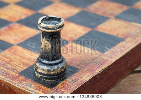 vintage wooden chess rook in the corner of chessboard