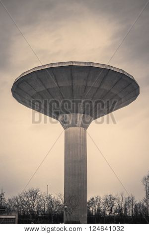 Water Tower In Cloudy Weather