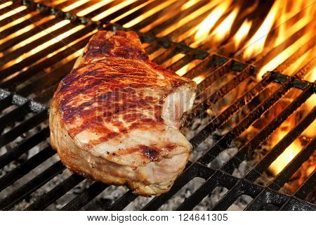 Single Pork Loin Steak On Hot With Fork
