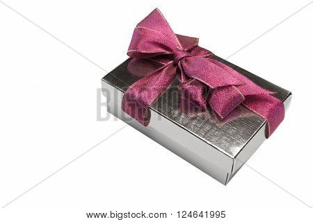 One Silver Gift Box Tied With Big Purple Bow Isolated On White Background Close-up Top View