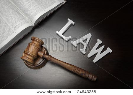 Judges Gavel, Sign Law And Book On Black Wood Background,