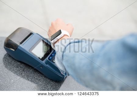 Woman using smart watch for payment