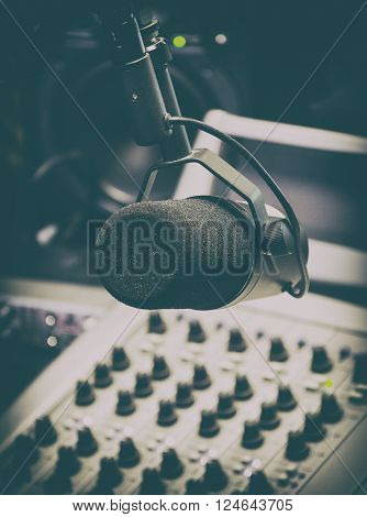 Microphone and mixing panel in radio studio.