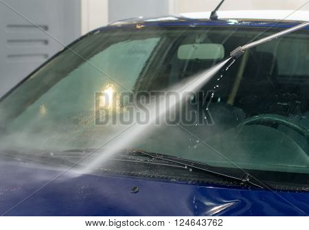 Car wash using high pressure water jet.