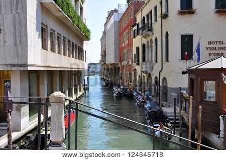 VENICE-JUNE 15: Narrow Venetian canal with gondolas on June 15 2012 in Venice Italy.