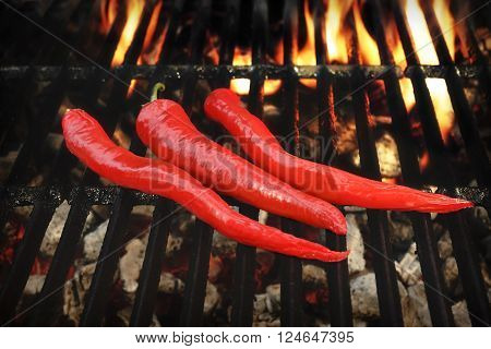 Three Hot Chili Peppers On The Flaming Bbq Grill