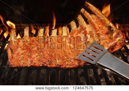 Pork Baby Back Or Spareribs On Bbq Grill With Flames