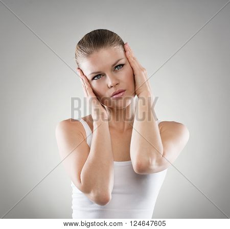 Depressed woman suffering from insomnia. Migraine or headache concept.