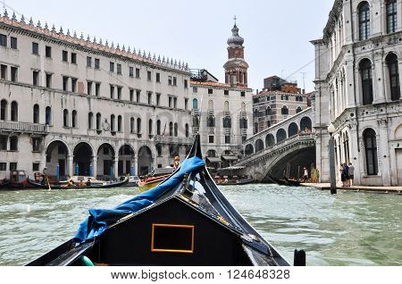 VENICE-JUNE 15: Gondola on the Venetian Grand Canal with the Rialto Bridge on June 15 2012 in Venice Italy.