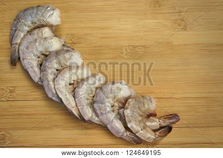 Many Raw Green King Size Shrimps On Wooden Background