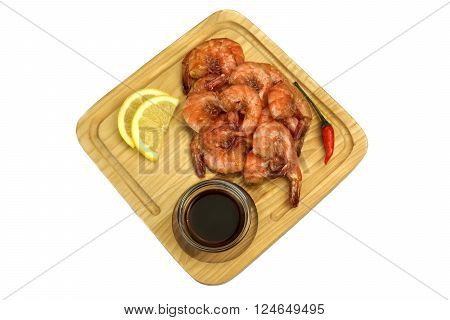 Grilled King Size Shrimps With Sauce Served On Wood Board