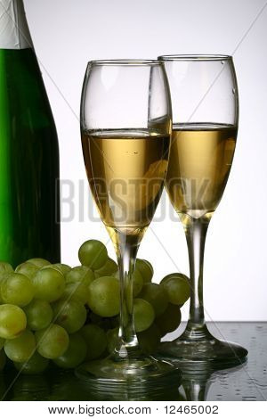 champagne grape and green bottle