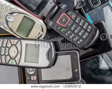 Pile of old and used mobile phones