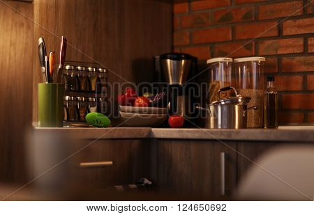Modern kitchen furniture with coffee maker, food and utensils