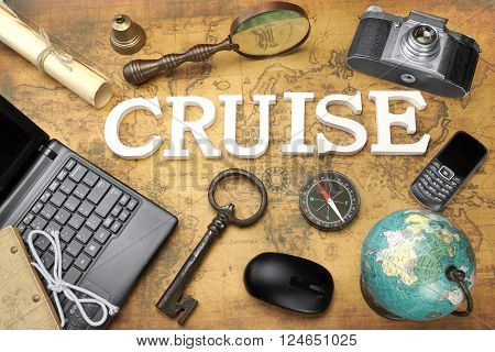 Wooden Sign Cruise Laptop Vintage 35mm Photo Camera Retro Key Globe Magnifier Compass GSM Phone Computer Mouse And Letter On The Old Map Flat Lay Top View