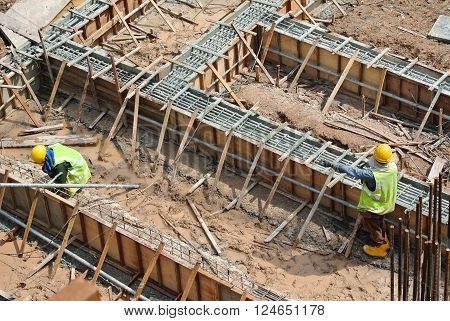 SELANGOR, MALAYSIA - OCTOBER 26, 2015: Ground beam form work constructed by workers at the construction site.