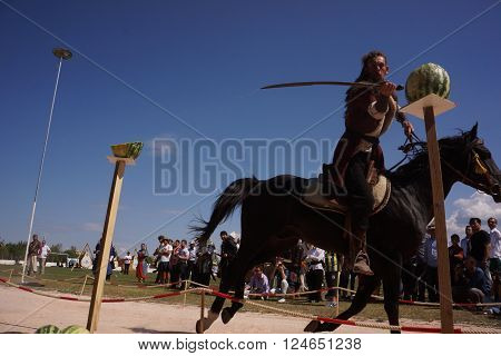 CANAKKALE,TURKEY-SEPTEMBER 8, 2013 : Biga played host to hundreds of archers at the third annual Osman Bey Traditional Archery Competition, including Turkish archers dressed like Ottoman janissaries on September 8, 2013 in Canakkale,Turkey