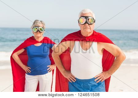 Senior coiple wearing superman costume on a sunny day