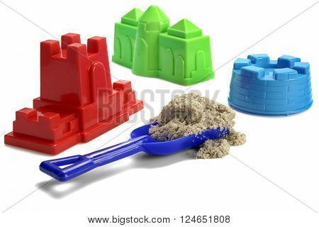Plastic Shovel With Sand And  Colored Molds On White Background