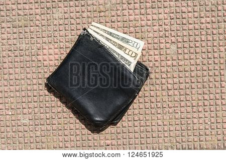 purse on the ground with money. Lost wallet