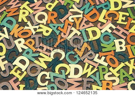 Tonned Random English Wooden Multicolored Letters On  Wood Background