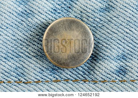 old metal button of jeans fashion, clothing industry