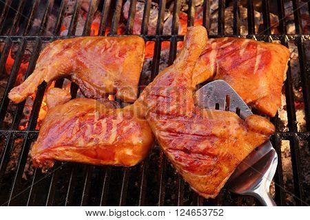 Four Chicken Leg Quarter Roasted On Hot Charcoal Flaming Grill