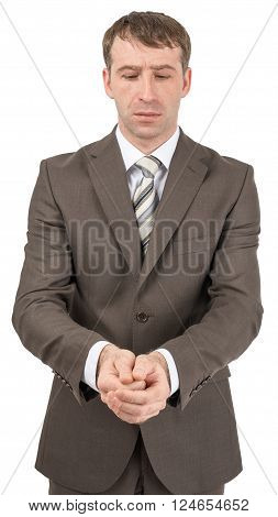 Unhappy businessman looking at his hands in front of him