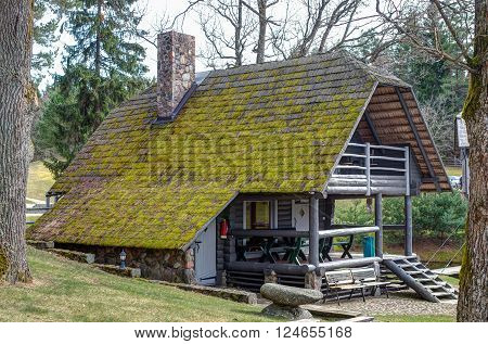 The old bathhouse in rural. The roof overgrown with moss.
