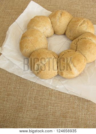 Homemade roll wreath on white greaseproof paper