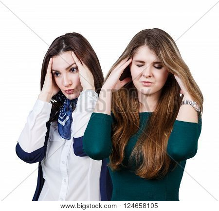 Two women with a headache isolated on white background