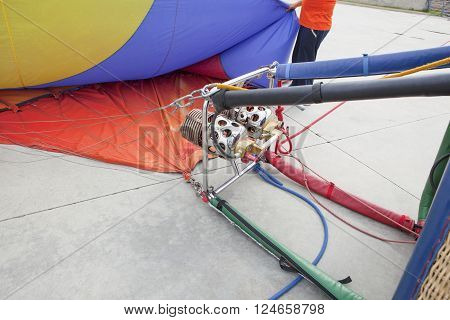 Hot-air balloon burners on the ground deflating
