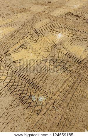 wheel trace off road on muddy soil