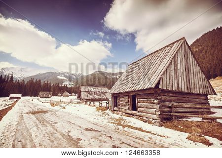 Old Film Retro Stylized Wooden Hut By A Road In Tatra Mountains.