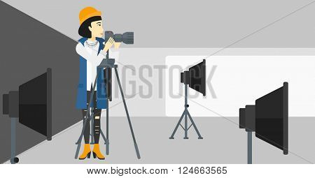 Photographer working with camera on a tripod.