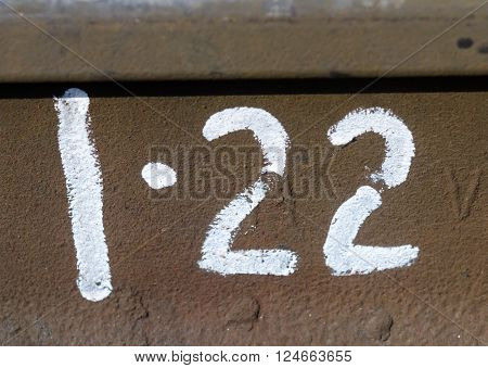 Number twenty two typed on the metall plate