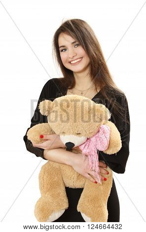 nice long-haired girl with a toy bear. isolated on a white background