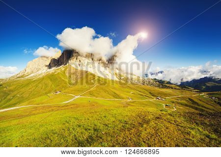View of the foggy Gardena valley. National Park Dolomites (Dolomiti) pass Sella. Location Sassolungo group, South Tyrol, Alp, Italy, Europe. Picturesque scene. Artistic picture. Beauty world.