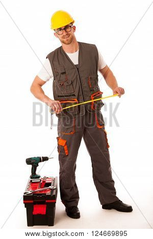 Diy - Young Man Measuring With Meter  Equiped With Toolkit And Batery Drill Isolated Over White Back