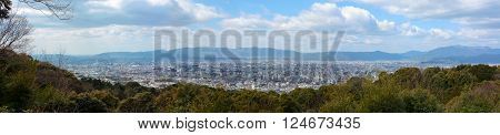 Super wide panorama of Kyoto city in Japan and the surrounding landscape and mountains