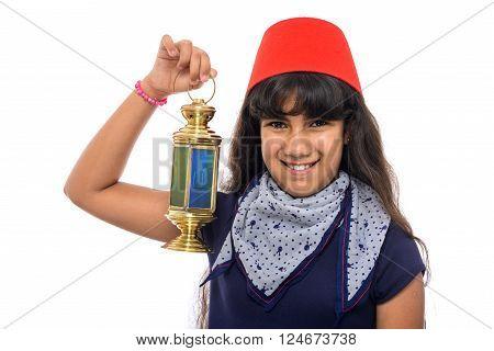 Happy Female Teenager With Red Fez Holding Ramadan Lantern