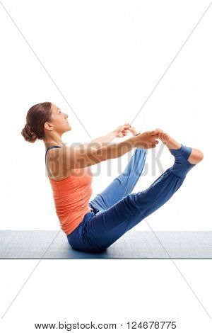 Beautiful sporty fit woman doing Ashtanga Vinyasa yoga asana Upavistha konasana B - wide sitted forward bend B isolated on white