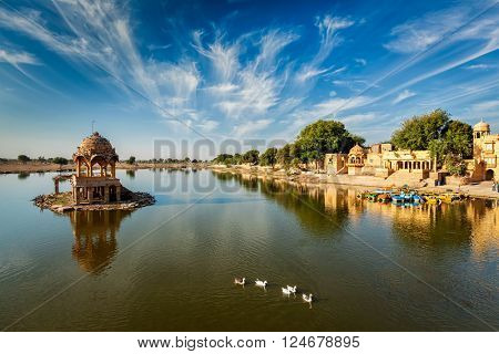Indian landmark Gadi Sagar - artificial lake with white swans. Jaisalmer, Rajasthan, India